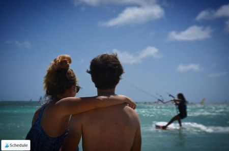 insta-@daphneonacloud-photo-of-couple-watching-kite-surfing-at-aruba-hi-winds-visitaruba-blog