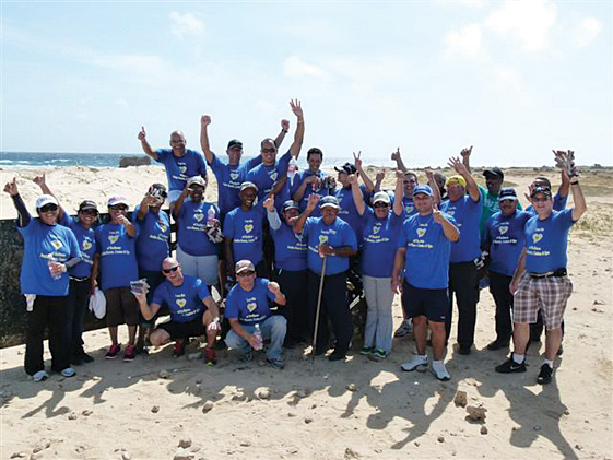 Employees of the Radisson Aruba Resort work together towards a more beautiful island