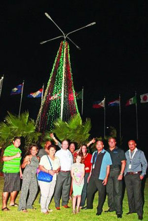 The new rotunda at the Reina Beatrix International Airport of Aruba also following the holiday trend, adorned with a brilliant display of lights to brighten the international collection of flags