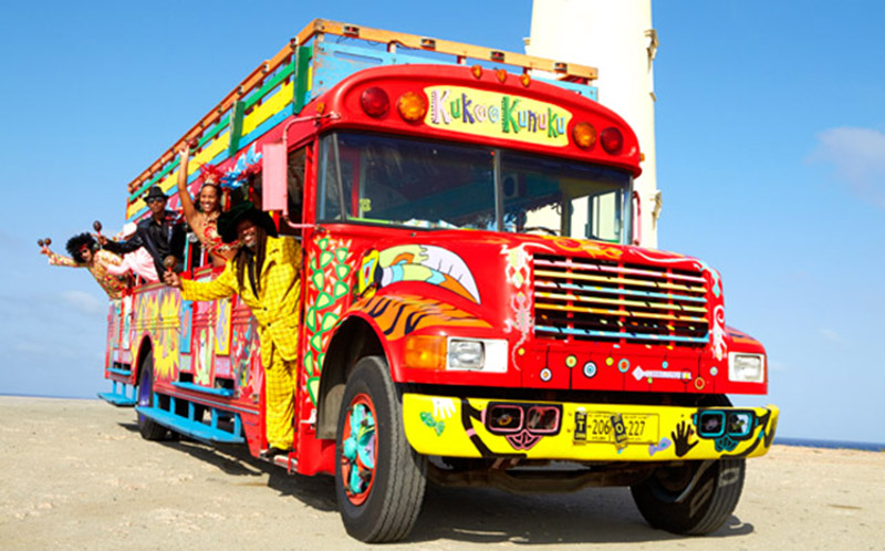 Aruba's craziest bus, the Kukoo Kunuku, offering summer time Family Friendly Daytime Tours