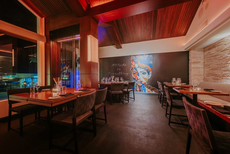 Interior-of-venue-LG-Smiths-Steak-and-Chop-house-Warm-Toned-Mural-of-Woman-with Attitude