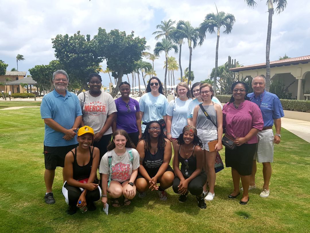 Group picture of professors and students from U.S.-based Mercer University gather with Ewald Biemans (far right), owner/CEO of Bucuti & Tara Beach Resort and noted environmentalist