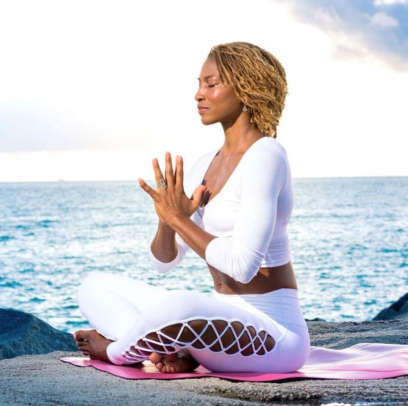 koya-web-practicing-yoga-in-aruba-at-hilton-resort