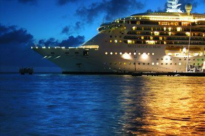 Photo of a cruise ship in port in the early evening